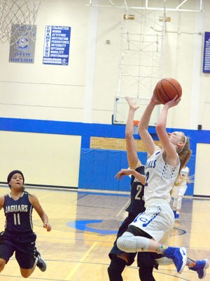 Carlsbad's Carsyn Boswell jumps for an and-one layup in the third quarter Friday against Atrisco Heritage.