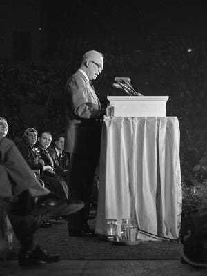 While U.S. Sen. Joseph McCarthy (second from right) leans in to listen, Republican presidential nominee Dwight D. Eisenhower addresses a crowd of 10,000 at the Milwaukee Arena during a campaign stop on Oct. 3, 1952. Also listening on stage: Charles Ashley, Milwaukee County Republican chairman; Mamie Eisenhower; and U.S. Rep.Charles Kersten (R-Wis.). This photo was published in the Oct. 4, 1952, edition of the Milwaukee Journal.