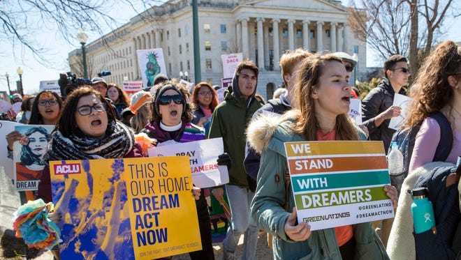 Deferred Action for Childhood Arrivals (DACA) recipients and other young immigrants march with supporters as they arrive at the Capitol in Washington, D.C., on March 5, 2018.
