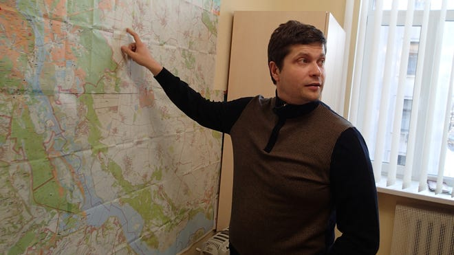 Pavlo Rizanenko, a member of parliament, points at his district on a map. Rizanenko says Ukraine needs to take drastic steps to defend itself, and must consider re-arming with nuclear weapons.