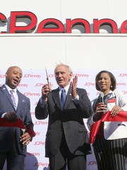 Flanked by JCPenney CEO Marvin Ellison, left, and General Manager Christen Barron, Mayor Jerry Gist cuts the ribbon during the Old Hickory Mall JCPenney grand re-opening on Nov. 19.