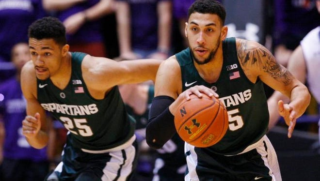 Jan 28, 2016; Evanston, IL, USA; Michigan State Spartans guard Denzel Valentine (45) and forward Kenny Goins (25) on a fast break against the Northwestern Wildcats during the first half at Welsh-Ryan Arena.