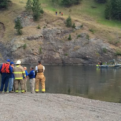 A woman died after her vehicle entered the river at