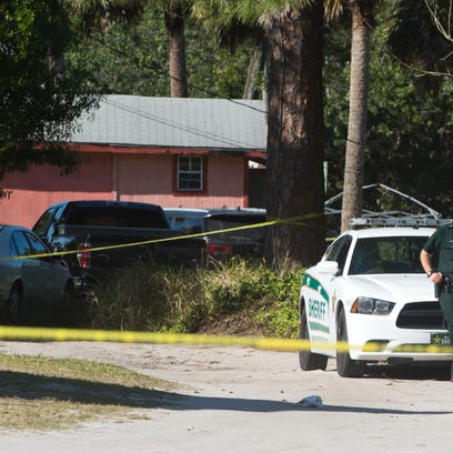 An Indian River County Sheriff's deputy secures the