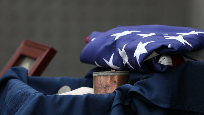 An American flag presented by Oregon-based Civil War re-enactors is placed with the cremains of Civil War soldier Pvt. Jewett B. Williams during a ceremony on Monday, Aug. 1, 2016, at the Oregon State Hospital Cremains Memorial in Salem, Ore. Williams died at the hospital in 1922, and his cremains were never claimed, until now. Patriot Guard Riders will provide Williams an escort to his final resting place in his home state of Maine.
