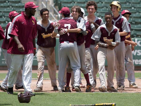 Members of the Bayshore Christian School baseball team celebarate a state championship 2A semifinal win over Seven Rivers Christian School in 11 innings. The team plays Thursday for the state title.