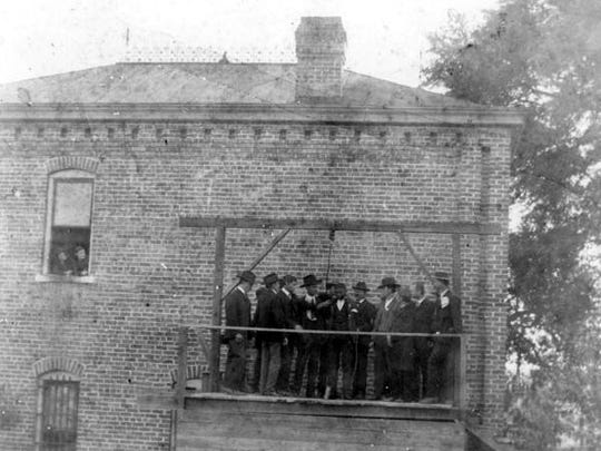 The Leon County jail, at Gaines and Meridian, in the early 1900s -- and the gallows where a black man is being hung. Lore holds that black men were lynched at a nearby tree in 1897 and 1909.