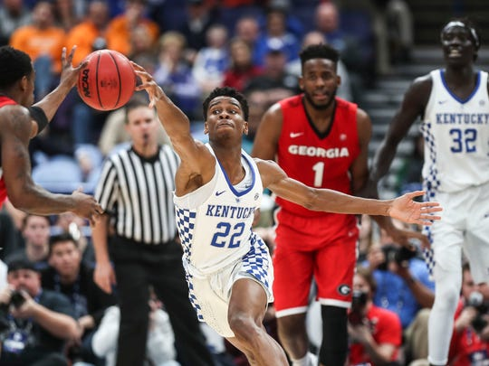 Kentucky's Shai Gilgeous-Alexander goes for a steal against Georgia Friday afternoon in the 2018 SEC Tournament at the Scotttrade Center in St. Louis. Alexander finished with 15 points.