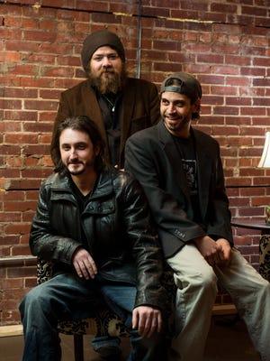 Members of the band Lower Case Blues Jake Banaszak, left, Paul Weik and BJ Muntz.