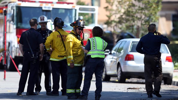 Police and firefighters investigate the scene after
