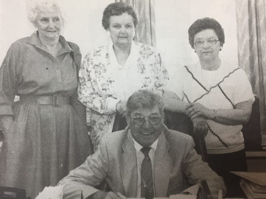 Judge-executive James Veach declared May as Older Americans Month in Union County in May 1993. Present for the signing were, from left, Hilda Potts of Sturgis, Gebo Wilson of Morganfield, and Nadine Hargrove of Uniontown.