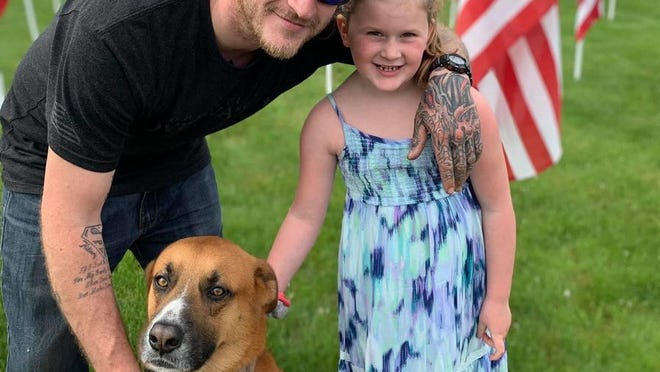 Brock, a service dog to veteran Steven Laine, shown with his daughter Livie, was fatally struck by a car on Route 28 after being startled by July Fourth fireworks in a Dennis neighborhood and running off.