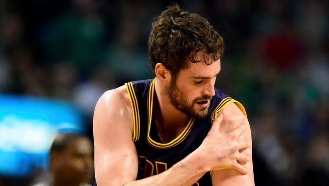Kevin Love suffered a dislocated left shoulder against the Celtics.