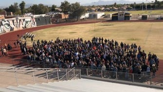 About 200 students at Gilbert High School met at the school stadium on February 21, 2018, to honor the 17 people who were gunned down at Marjory Stoneman Douglas High School.