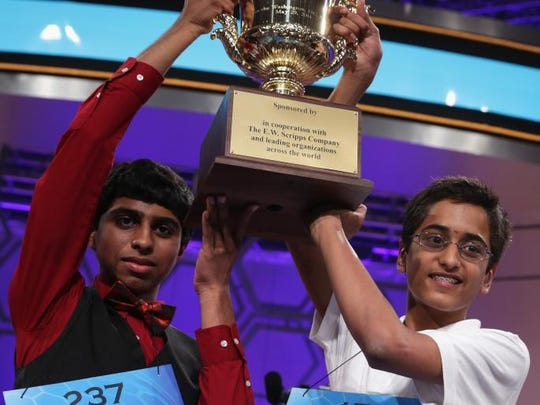 Sriram Hathwar, right, of Painted Post, and Ansun Sujoe, left, of Fort Worth, Texas, hold their trophy at the end of the 2014 Scripps National Spelling Bee competition May 29, 2014 in National Harbor, Maryland. Hathwar and Sujoe were declared as co-champions after 22 rounds of the competition.