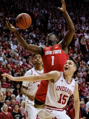 Ohio State forward Jae'Sean Tate (1) goes for a rebound behind Indiana guard Zach McRoberts (15) during the first half of an NCAA college basketball game in Bloomington, Ind., Friday, Feb. 23, 2018. (AP Photo/AJ Mast)