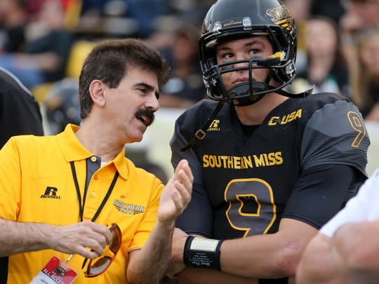 A member of the Southern Miss medical staff talks to quarterback Nick Mullens after he left last week's game with an injury. A member of the Southern Miss medical staff talks to quarterback Nick Mullens after he left last week's game with an injury.