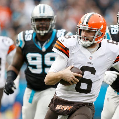 Cleveland quarterback Brian Hoyer (6) looks to slide as he runs away from the Carolina Panthers' defense during a Dec. 21 game in Charlotte, N.C.