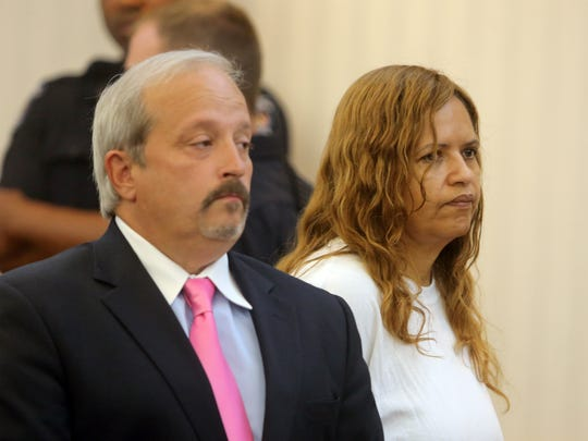 Diana Nadell stands with attorney Luis Penichet in Clarkstown Town Court as she is arraigned June 4, 2014 on a first degree murder charge in the death of her mother-in-law Peggy Nadell. Diana Nadell is accused of stabbing and beating the Valley Cottage resident on January  25, 2014.