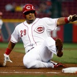 Reds catcher Brayan Pena is forced out at third base against the Milwaukee Brewers during the second inning in game two of a doubleheader at Great American Ball Park.