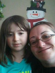 Erica Bradfield, right, with her daughter, Eden Fox. Bradfield's slain body was found in several trash bags Friday.