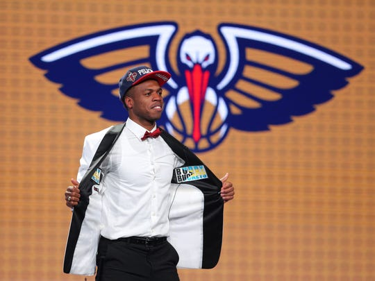 Jun 23, 2016; New York, NY, USA; Buddy Hield (Oklahoma) shows off the inside of his jacket after being selected as the number six overall pick to the New Orleans Pelicans in the first round of the 2016 NBA Draft at Barclays Center. Mandatory Credit: Brad Penner-USA TODAY Sports ORG XMIT: USATSI-269318 ORIG FILE ID: 20160623_jel_ae5_070.jpg