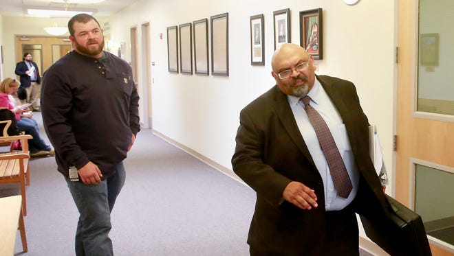 Defendant Tyler Black, left, and attorney Emet Rudolfo enter the courtroom on Wednesday at Farmington District Court.