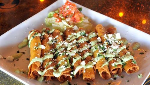 A Taquitos platter from Sir Veza's Taco Garage.
