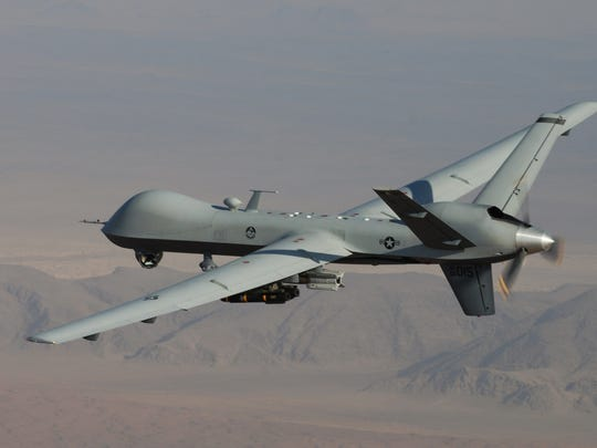 An MQ-9 Reaper drone armed with Hellfire missiles.