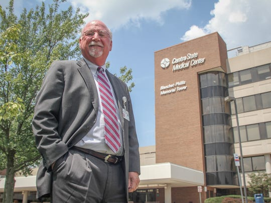 John Gribbin, CEO of CentraState Healthcare System, stands in front of the Freehold Township hospital.