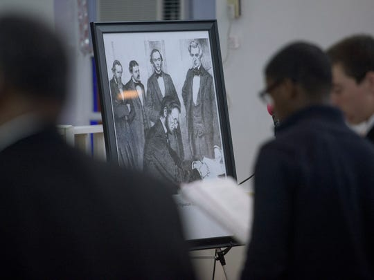 A print of Abraham Lincoln signing the Emancipation Proclamation Celebration is shown at Bryant Missionary Baptist Church in Montgomery, Ala. on Sunday January 1, 2017.