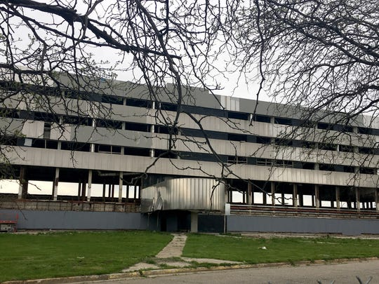 A newly erected sign says that the old Southwest Detroit Hospital, empty since 2007, could be redeveloped by 2020.