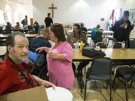 Michael Graves, who is homeless, eats a free meal at the First Congregational United Church of Christ.