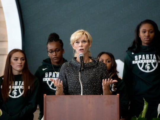 Michigan State women's basketball coach Suzy Merchant speaks surrounded by the team during the Gilbert Pavilion and Tom Izzo Hall of History dedication on Friday, Oct. 20, 2017, at the Breslin Center in East Lansing.
