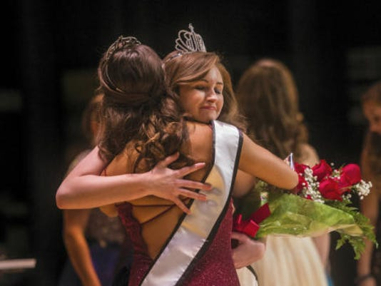 The new 2015 Miss Hanover Area Abigail Bachman hugs predecessor Katherine Hernandez during the pageant at Hanover High School on Monday.