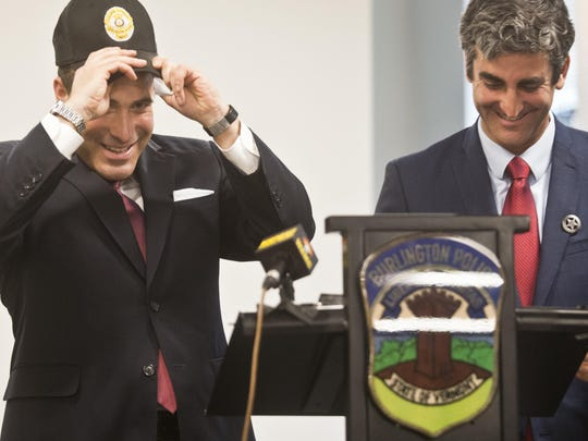 Deputy Inspector Brandon del Pozo of the New York City Police Department, left, dons a Burlington police cap during a news conference Tuesday. Del Pozo is Mayor Miro Weinberger's top pick as BPD's next chief.