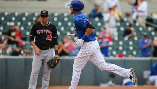 Iowa Cubs third baseman Kris Bryant circles the bases after hitting a home run June 23 against the Albuquerque Isotopes.