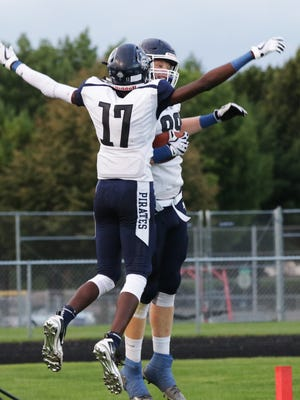 Bay Port's Cordell Tinch (17) and Jack Plumb (89) celebrate a touchdown against Sheboygan North on Thursday in Sheboygan.
