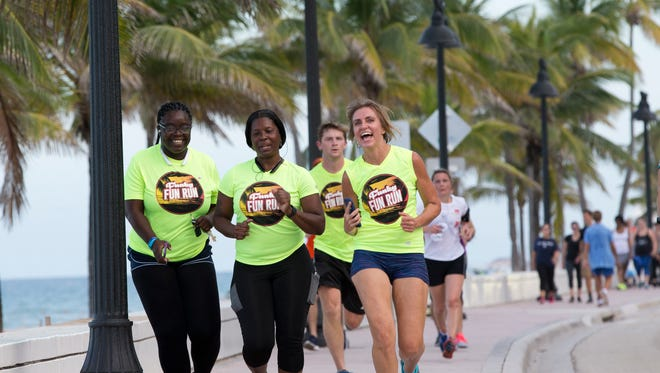 "In this Aug. 4, 2016 photo, runners with the Westin Ft. Lauderdale Beach Resort's weekly run club run towards the hotel in Fort Lauderdale, Fla. For years, business networking has centered around food and alcohol. Now it's all about grabbing your running shoes or unrolling your yoga mat and bonding over a fitness class thanks to ""sweatworking."" (AP Photo/Wilfredo Lee)"