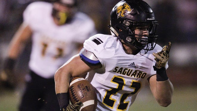 Saguaro senior running back Stone Matthews rushes against Sunrise Mountain in the first half at Sunrise Mountain High School in Peoria on Friday, Sept. 23, 2016.
