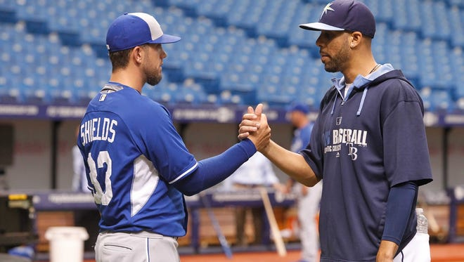 Kansas City Royals starting pitcher James Shields, left, and Tampa Bay Rays starting pitcher David Price talk before a game.