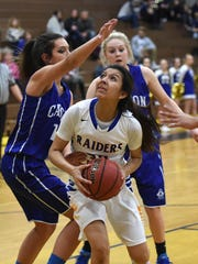 Reed's Larsa Guzman looks to shoot with Carson's Dajarrah