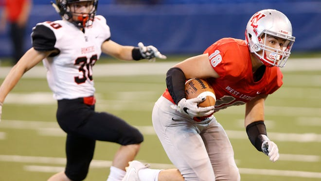 Sage Hood with a long touchdown run at 7:19 in the first quarter to put the Red Devils up 14-0 over Rensselaer Saturday, September 16, 2017, at Lucas Oil Stadium in Indianapolis.