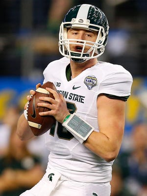 ARLINGTON, TX - JANUARY 01: Connor Cook #18 of the Michigan State Spartans passes against the Baylor Bears during the first half of the Goodyear Cotton Bowl Classic at AT&T Stadium on January 1, 2015 in Arlington, Texas. (Photo by Tom Pennington/Getty Images)