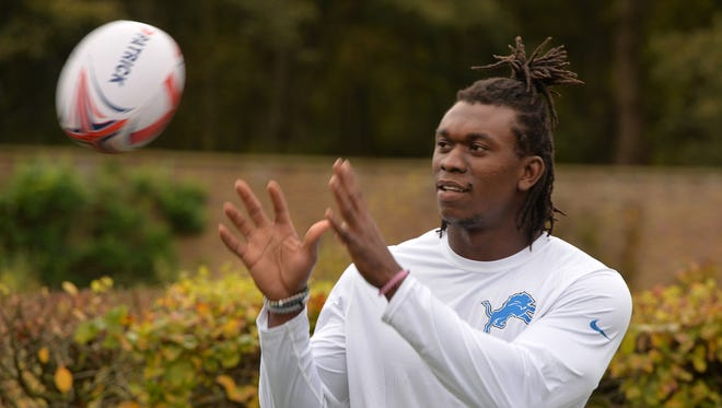 Detroit Lions defensive end Ezekiel Ansah catches a rugby ball during practice at The Grove in preparation of the NFL International Series game against the Kansas City Chiefs.