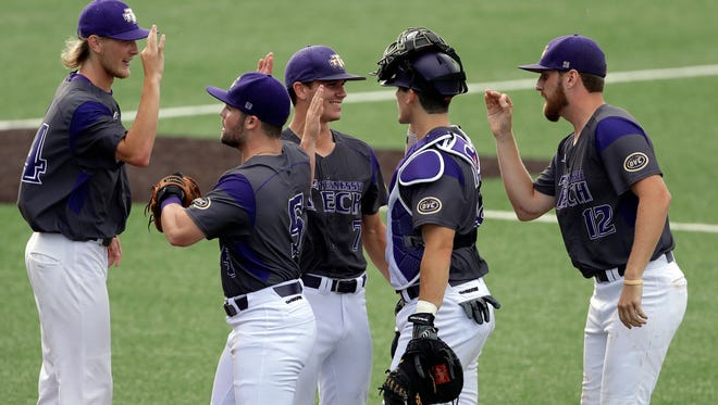 Tennessee Tech pitcher Ethan Roberts (7) celebrates with teammates Zack Wilcox (34), Trevor Putzig (5), Brennon Kaleiwahea (28) and Colton Provey (12) after their win over Texas in an NCAA college super regional baseball game, Saturday, June 9, 2018, in Austin, Texas. Tennessee Tech won 5-4.