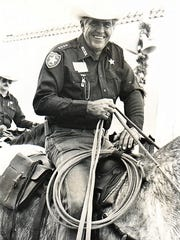 Sheriff James Holt on his horse in Dec. 1987.