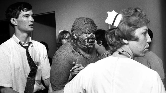 The Topeka Capital-Journal's Delmar Schmidt shot this photo of mud-caked, bleeding radio reporter Rick Douglass entering Stormont Vail Hospital after being hurt by the tornado that devastated Topeka 54 years ago next Monday. The photo was later published in Life magazine.