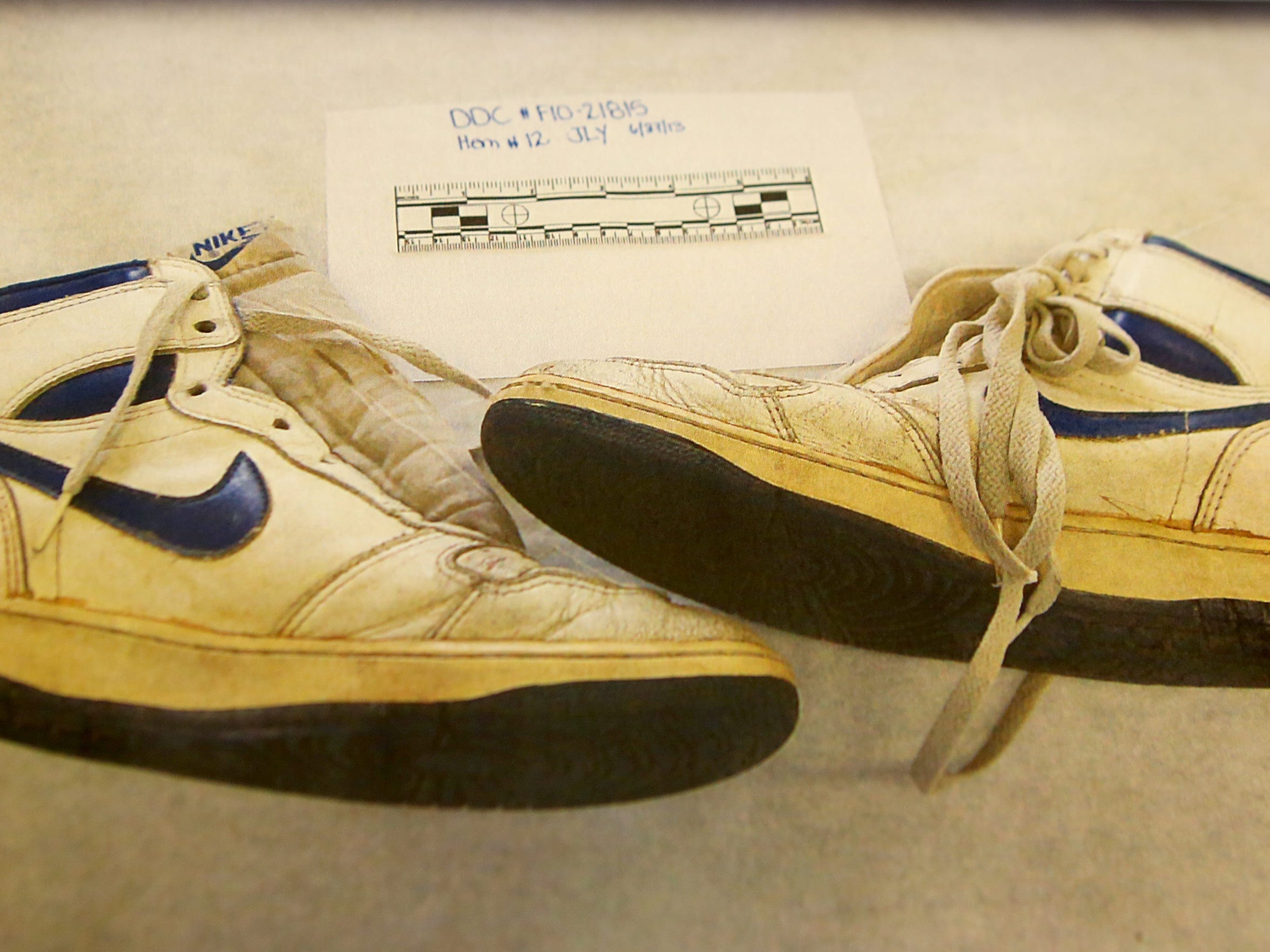 William Virgil's tennis shoes were confiscated as evidence