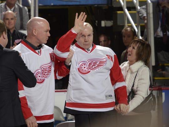 Former Red Wings defenseman Vladimir Konstantinov waves
